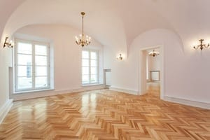 Room with patterned hardwood flooring