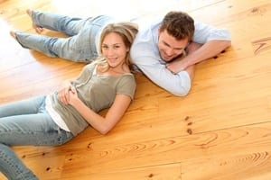 Couple at home relaxing on the floor
